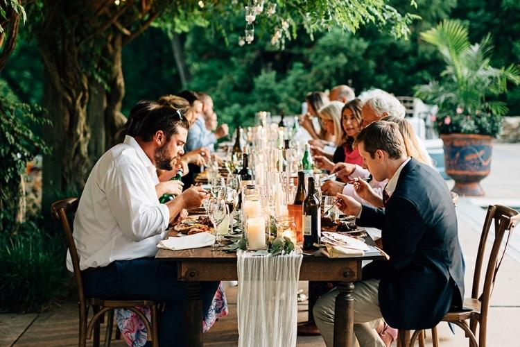 Helen and Chris: A Micro Wedding in Lancaster PA - guests eat at one table to celebrate