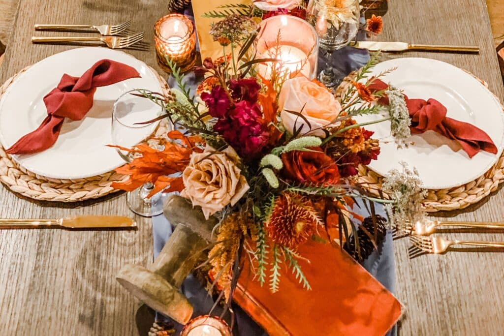 6 Easy Steps to Create the Perfect Thanksgiving Table Design, floral designs and Thanksgiving table design - fall harvest table setup closeup