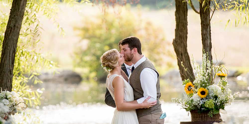 Lancaster Rustic Wedding ceremony lakeside kiss