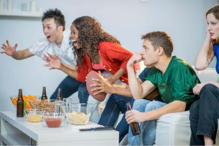super-bowl-party-people-watching-the-game-game-day-tips-for-a-covid-safe-super-bowl-party-the-jdk-group-catering-harrisburg-lancaster-york